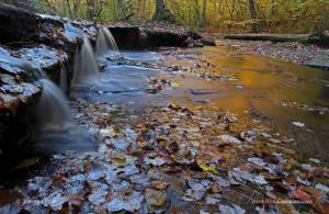 Behind the Autumn Photography Image of Stepstone Falls in Rhode Island